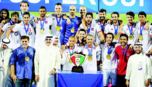 Super Cup champions Kuwait SC celebrate on the podium with officials. Super Cup champions Kuwait SC celebrate on the podium with officials.