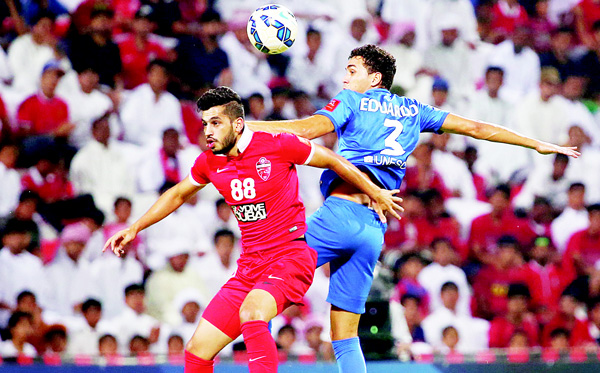 Majed Hassan (left), of UAE's Al-Ahli fights for the ball against Carlos Eduardo of Saudi's Al-Hilal during their AFC Champions League semifinal football match on Oct 20, in Dubai. (AFP)