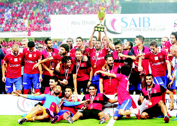Egypt's Al-Ahly's players celebrates with their trophy after winning the Egypt super cup football match against Egypt's Zamalek on Oct 15, at Sheik Hazza Bin Zayed Stadium in Al-Ain, UAE. (AFP)