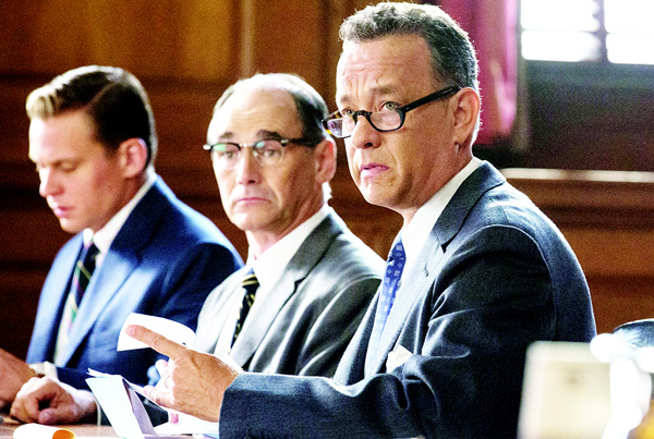 In this image released by Disney, Tom Hanks (from right): Mark Rylance and Billy Magnusson appear in a scene from the film, 'Bridge of Spies'. 'Bridge of Spies' collected $15.4m at the US box office. (AP)
