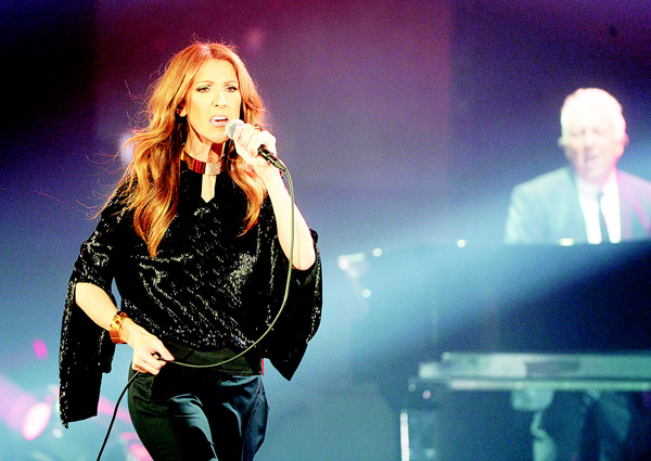 This file picture taken on Nov 25, 2013 shows Canadian singer Celine Dion performing during her first of seven shows scheduled until Dec 5 at the Bercy's Palais Omnisports in Paris. (AFP)