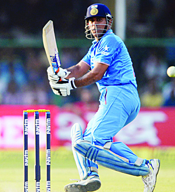 India's captain Mahendra Singh Dhoni plays a shot during the first One-Day International (ODI) cricket match between India and South Africa at Green Park Stadium in Kanpur on Oct 11. (AFP)