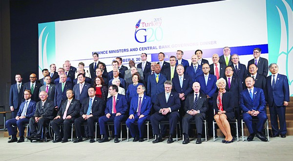 Finance Ministers and Central Bank Governors from the G20 pose for a group picture with International Monetary Fund (IMF) Managing Director Christine Lagarde (second right front row), and World Bank President Jim Yong Kim (first right front row), in Lima, Peru. The world's finance ministers and central bankers are in Lima for the joint annual meetings of the World Bank and IMF that run through Sunday. (AP)