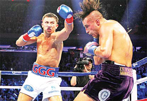 Gennady Golovkin (left), hits David Lemieux in the second round of a middleweight title fight at Madison Square Garden in New York on Oct 17. (AP)