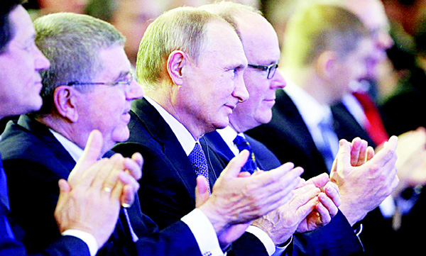 From left: Russia's Olympic Committee President Alexander Zhukov, International Olympic Committee (IOC) President Thomas Bach, Russian President Vladimir Putin and Prince's Albert II of Monaco attend the World Olympians Forum in Moscow on Oct 21. (AFP)