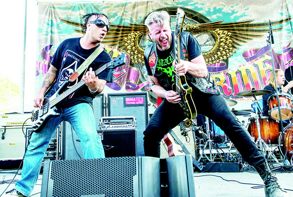 Dave Briggs (left), and Dan 'Hitman' Cord of the band American Hitmen perform during the 32nd Love Ride at Castaic Lake on Oct 18, in Castaic, California. (AP)