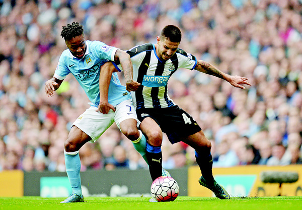 Manchester City's English midfielder Raheem Sterling (left), vies with Newcastle United's Serbian striker Aleksandar Mitrovic during the English Premier League football match between Manchester City and Newcastle United at The Etihad Stadium in Manchester, north west England on Oct 3. (Inset): Southampton's Senegalese midfielder Sadio Mane (left), falls to the ground in the penalty area after a challenge by Chelsea's Brazilian midfielder Ramires (center), during the English Premier League football match between Chelsea and Southampton at Stamford Bridge in London on Oct 3. (AFP)