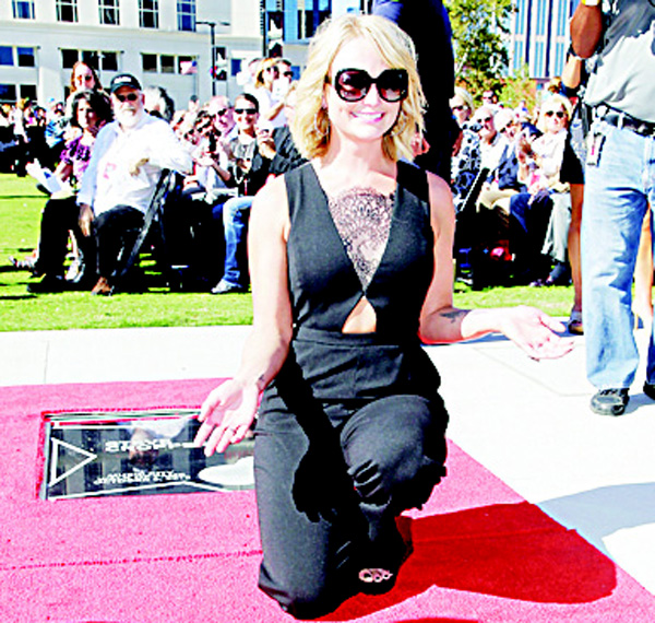 Country music singer Miranda Lambert poses with her star on the Music City Walk of Fame on Oct 6, in Nashville, Tenn. (AP)