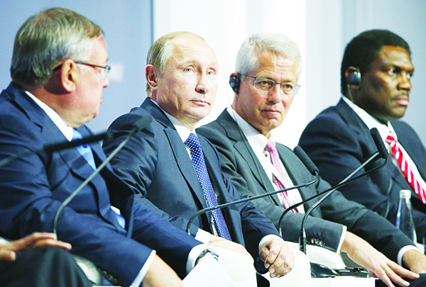 Russian President Vladimir Putin (second left), attends the 7th annual VTB Capital 'Russia Calling!' Investment Forum in Moscow, Russia. S&P says the outlook for Russia's recession-hit economy remains weak as it struggles with sanctions and lower oil prices. (AP)