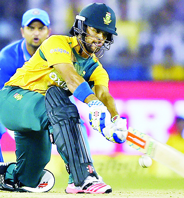 South Africa's Jean-Paul Duminy plays a shot during their second Twenty20 cricket match against India in Cuttack, India on Oct 5. (AP)