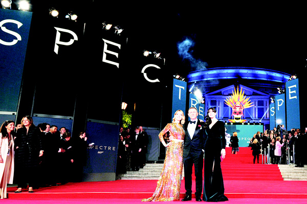 (Left to right): French actress Lea Seydoux, British actor Daniel Craig and Italian actress Monica Bellucci pose on arrival for the world premiere of the new James Bond film 'Spectre' at the Royal Albert Hall in London on Oct 26. The film is directed by Sam Mendes and sees Daniel Craig play suave MI6 Spy 007 for a fourth time. (AFP)