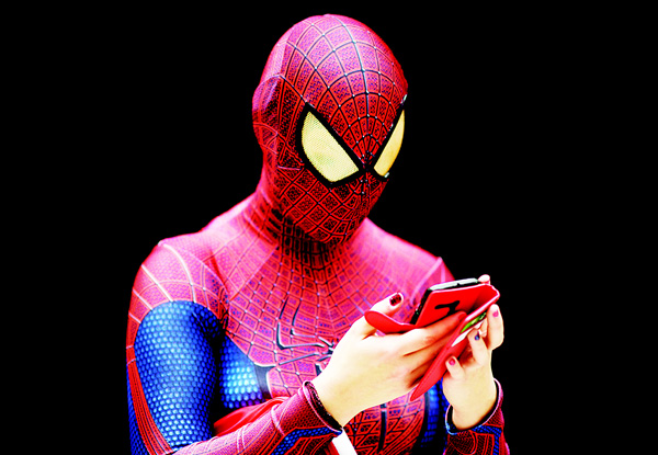 A woman dressed as Spiderman uses her mobile phone at the  MCN Comic Con in east London, on Oct 23. The event is the largest of its type in the UK and sees fans and enthusiasts flock to the ExCel Centre to meet their heroes, browse merchandise and see previews of upcoming releases. (AFP)