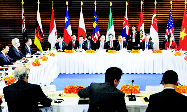 This file photo taken on Nov 10, 2014 shows US President Barack Obama (3rd right) taking part in a meeting with leaders from the Trans-Pacific Partnership (TPP) at the US Embassy in Beijing on the sidelines of the 2014 APEC Summit. Japan's Prime Minister said on Oct 5, that a dozen nations have reached 'broad agreement' on the Trans-Pacific Partnership, which aims to become the world's largest free-trade zone, after days of talks. (AFP)