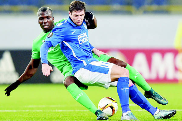 FC Dnipro's Yehven Seleznyov (right), and AS Saint-Etienne Florentin Pogba vie for ball during the UEFA Europa League Group G football match FC Dnipro vs AS Saint-Etienne at the Dnipro Arena Stadium in Dnipropetrovsk on Oct 22. (Inset): Monaco's Joao Moutinho (left), battles for the ball with Qarabag's Richard Almeida during their Europa League Group J soccer match in Monaco Stadium on Oct 22. (AFP/AP)