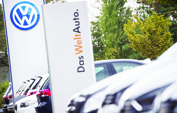 This file photo shows the German car maker Volkswagen logo at a VW dealer in Berlin. The German transport authorities plan to order auto giant Volkswagen to recall 2.4 million diesel vehicles in Germany that are equipped with pollution-cheating software, a spokesman told AFP on Oct 15. (AFP)