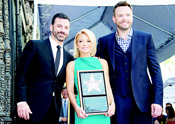 Left to right: Jimmy Kimmel, Kelly Ripa and Joel McHale attend the ceremony honoring Kelly Ripa with a star on Hollywood Walk of Fame in Los Angeles, California, on Oct 12. (AFP)
