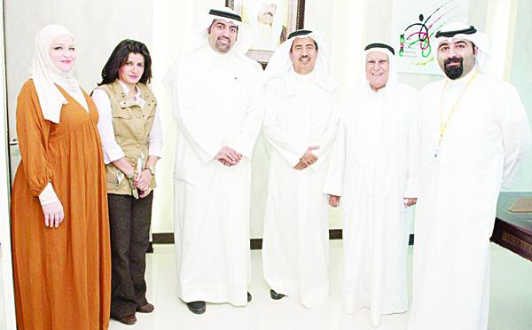 Dr Hamoud Al-Mudhaf (KOSAC), Jasem Al-Salman (ABK), Yousef Al-Abdulla (ABK), and KOSAC staff.