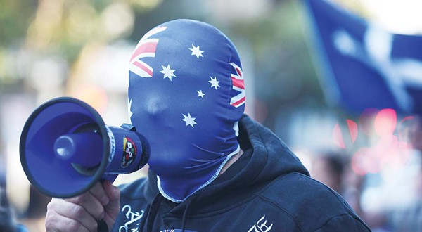 An anti-Muslim protester shouts slogans outside the Parramatta Mosque in Sydney