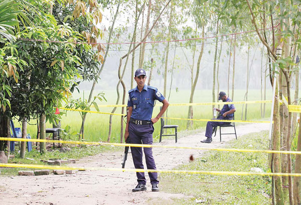Bangladeshi security officers stand by the site where a Japanese Kunio Hoshi was killed at Mahiganj village in Rangpur district, 300 kms (185 miles) north of Dhaka