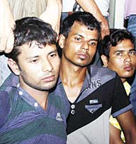 This photo taken on Oct 5, shows Mohammad Javed (left), an explosives expert with the Islamist group Jamayetul Mujahideen Bangladesh (JMB), being presented to the media following his arrest in Chittagong. (AFP)