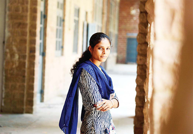 20-year-old Indian student Santa Devi Meghwal poses at her college in Jodhpur. Meghwal was only 11-months-old when her elders married her to a nineyear- old boy from a neighbouring village in the desert state of Rajasthan, where rates of child marriages have long been high. (AFP)