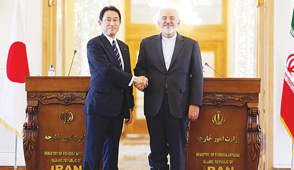 Iranian Foreign Minister Mohammad Javad Zarif (right), shakes hands with his Japanese counterpart, Fumio Kishida, following a press conference in the capital Tehran on Oct 12. (AFP)