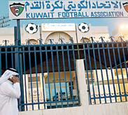 A man walks past the Kuwaiti Football Association (KFA)'s headquarters on Oct 17, 2015, in Kuwait City. (AFP)