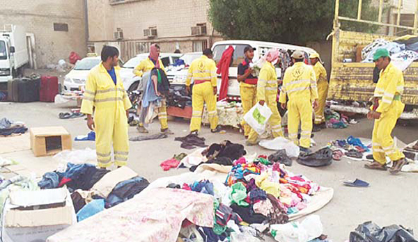 Municipality workers confiscate some of the items from the illegal markets from where 85 illegals were arrested