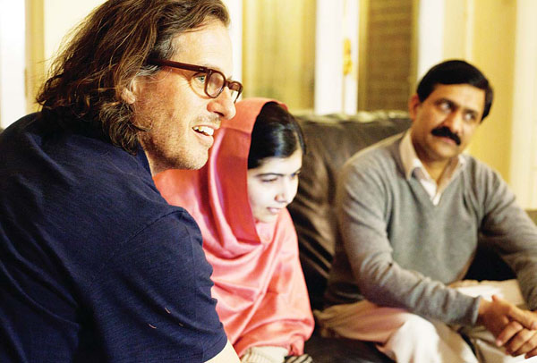 In this Dec 17, 2013 photo released by Twentieth Century Fox Film Corporation, director Davis Guggenheim appears in Birmingham, England with Malala Yousafzai, and Ziauddinuddin Yousafzai during the filming of the documentary, 'He Named Me Malala', released in US theaters on Friday. (AP)