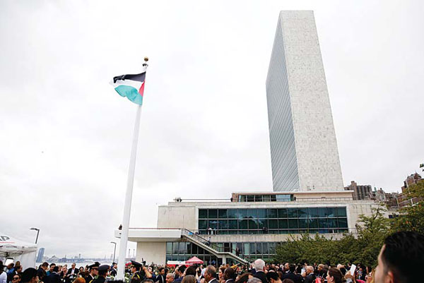 The State of Palestine flag files for the first time at the UN headquarters in New York, on Sept 30. (AFP)