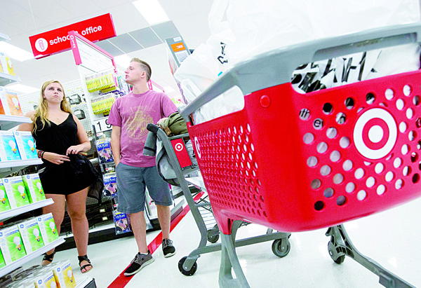 In this Aug 21, 2015, photo, Boston College students Alli Urbon (left), and Eddie Dols shop at the CityTarget store in Boston. The Commerce Department releases retail sales data for September on Oct 14. (AP)
