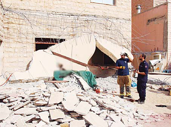 Security personnel at the site of collapsed wall in which the Arab expat died.