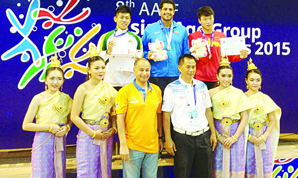 Kuwait's Ahmad Al-Bader (top center), poses with fellow winner and officials at  the podium in Bangkok.
