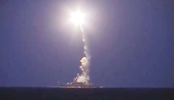 Russian warship launching a cruise missile in the Caspian Sea during a strike against Islamic State (IS) group's positions in Syria.