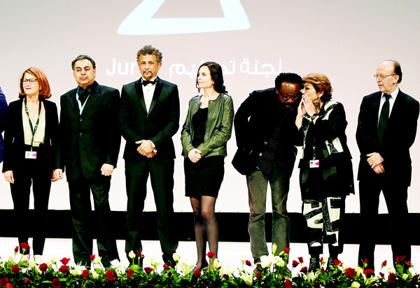 President of the jury of the 26th Carthage Film Festival, Morocco's Noureddine Sail (right), stands next to (from right to left) jury members Palestine's Leila Shahid, Nigeria's Newton Aduaka, Chile's Marcela Said, Egypt's Oussama Fawzi, French Tunisian Abel Jafri and Tunisia's Anissa Barrak during the opening ceremony on Nov 21, in the Tunisian capital Tunis. (AFP)