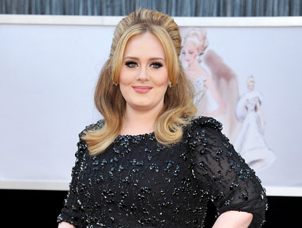 "FILE - In this Feb. 24, 2013 file photo, singer Adele arrives at the Oscars in Los Angeles. Adele releases her new album, ""25,"" on Friday, Nov. 20. (Photo by John Shearer/Invision/AP, File)"