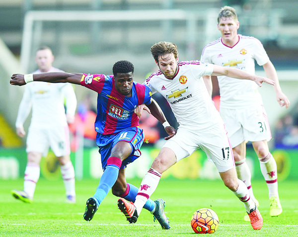 Manchester United's Dutch midfielder Daley Bling (right), vies with Crystal Palace's Ivorian-born English striker Wilfried Zaha during the English Premier League football match between Crystal Palace and Manchester United at Selhurst Park in south London on Oct 31. (AFP)