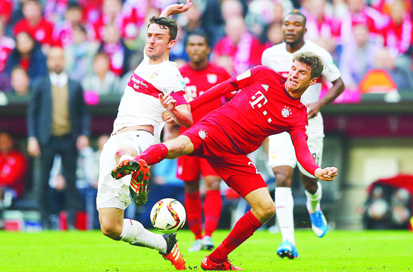Bayern's Thomas Mueller (right), Stuttgart's Christian Gentner challenge for the ball during the German Bundesliga soccer match between FC Bayern Munich and VfB Stuttgart in Munich, Germany on Nov 7. (AP)
