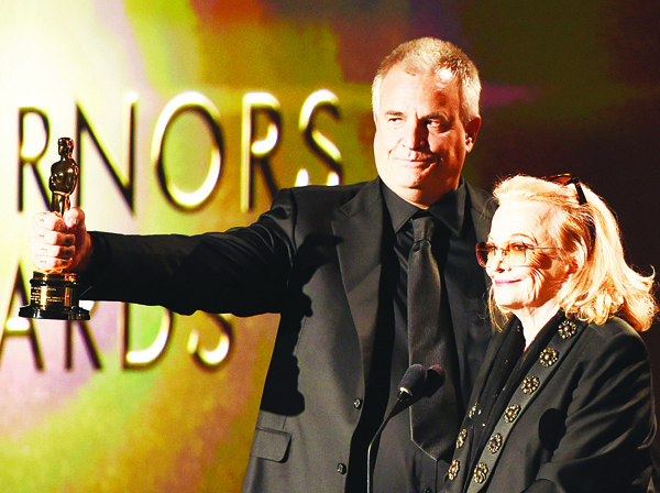 Gena Rowlands looks on as her son Nick Cassavetes holds her award during the 7th annual Governors Awards ceremony presented by the Board of Governors of the Academy of Motion Picture Arts and Sciences at the Hollywood & Highland Center in Hollywood, California on Nov 14. (AFP)