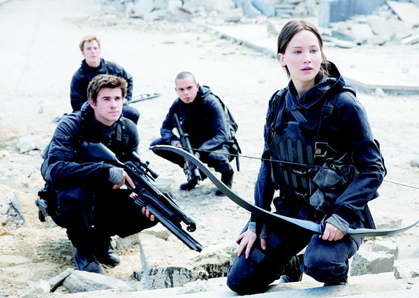 This image released by Lionsgate shows (from left), Liam Hemsworth as Gale Hawthorne, Sam Claflin as Finnick Odair, Evan Ross as Messalla and Jennifer Lawrence as Katniss Everdeen in a scene from 'The Hunger Games: Mockingjay Part 2,' 'Hunger Games' tops 'Good Dinosaur', 'Creed' heading into Thanksgiving. (AP)