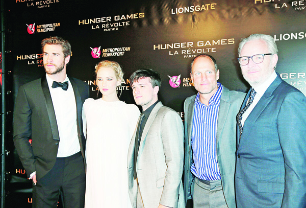 In this Nov 9 file photo (from left), Australian actor Liam Hemsworth, US actress Jennifer Lawrence, British actor Sam Claflin, US actor Woody Harrelson and US director Francis Lawrence pose for photographers at the premiere of the film 'The Hunger Games: Mockingjay Part 2', in Paris.(AP)