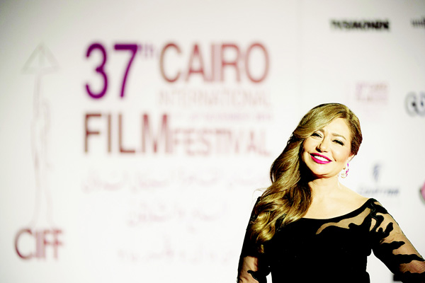 Egyptian film star Leila Elwi poses for photographers at the opening ceremony of the 37th Cairo International Film Festival at the Cairo opera house in the Egyptian capital on Nov 11. (AFP)