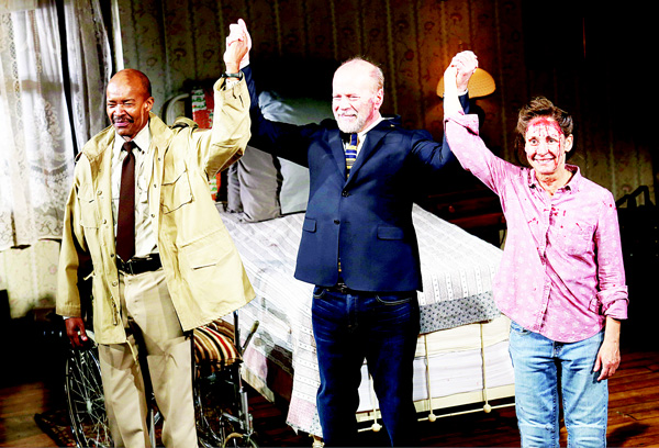 From left, Leon Addison Brown, Bruce Willis, and Laurie Metcalf appear on stage at the opening night curtain call of 'Misery' on Broadway at the Broadhurst Theatre on Nov 15, in New York. (AP)