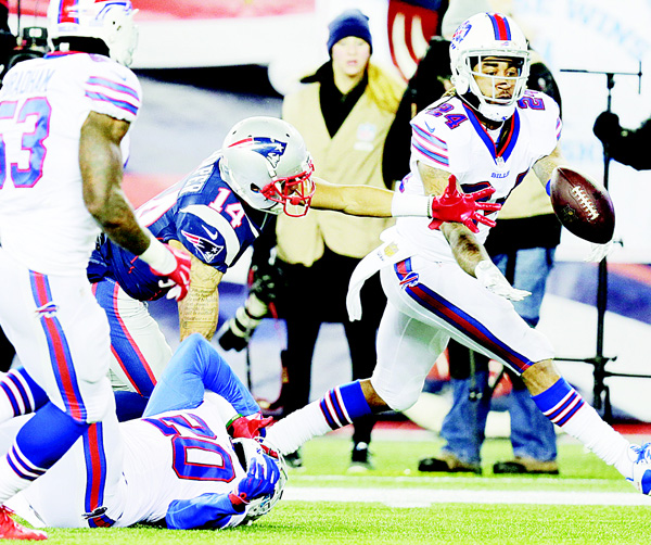 Buffalo Bills defensive back Stephon Gilmore (24) intercepts a pass intended for New England Patriots wide receiver  Chris Harper (14) in the second half of an NFL football game, on Nov 23, in Foxborough, Mass. (AP)