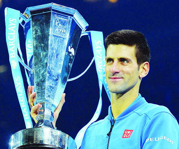 Serbia's Novak Djokovic poses with the ATP trophy after winning the men's singles final match against Switzerland's Roger Federer on day eight of the ATP World Tour Finals tennis tournament in London on Nov 22. (AFP)