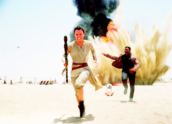 This photo provided by Disney shows Daisey Ridley as Rey (left), and John Boyega as Finn, in a scene from the new film, 'Star Wars: the Force Awakens.' Daniel Fleetwood a 31-year-old Texan who was suffering from cancer, had his wish granted to see the highly anticipated new 'Star Wars' film has died. (AP)