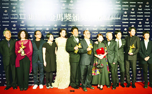 Taiwanese film director Hou Hsiao-hsien (fourth right), poses with the cast of his film 'The Assassin' after winning the Best Feature Film during the 52nd Golden Horse Film Awards in Taipei on Nov 21. (AFP)