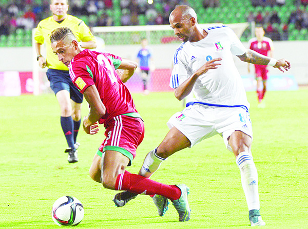 Morocco's Lazaar Achraf (left), vies for the ball with Equatorial Guinea's Iban Itanga Travieso during the World Cup 2018 qualifier football match between Morocco and Equatorial Guinea on Nov 12. (AFP)
