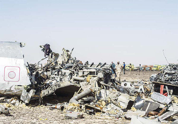 Debris belonging to the A321 Russian airliner are seen at the site of the crash in Wadi el-Zolmat, a mountainous area in Egypt's Sinai peninsulaon Nov 1. International investigators began probing why a Russian airliner carrying 224 people crashed in Egypt's Sinai peninsula, killingeveryone on board, as rescue workers widened their search for missing victims. (AFP)