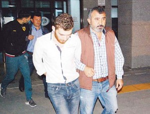 A 26-year-old Belgian citizen Ahmet Dahmani (back left), and a Syrian citizen (front left), are escorted by plain clothes police officers on Nov 20 in Antalya. Turkish police have arrested a Belgian man of Moroccan origin on suspicion he scouted out the target sites for Islamic State in attacks that killed 130 people in Paris a week ago, a Turkish government official said on Nov 21. (AFP)